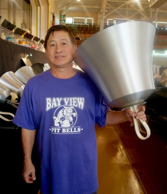 Larry Sue holding an aluminum C2 Hand Bell at Bay View Week of Handbells